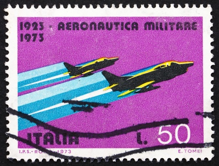 ITALY - CIRCA 1967: a stamp printed in the Italy shows G-91Y Fighters, 50th Anniversary of Military Aviation, circa 1967 Stock Photo - 14616615