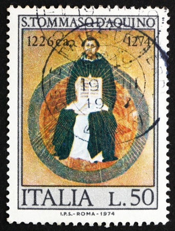 scholastic: ITALY - CIRCA 1974: a stamp printed in the Italy shows St. Thomas Aquinas, by Francesco Traini, Scholastic Philosopher, 700th Death Anniversary, circa 1974