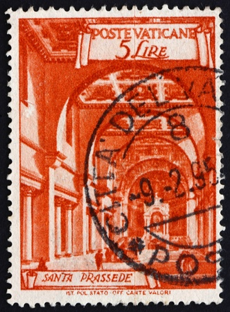 VATICAN - CIRCA 1949: a stamp printed in the Vatican shows Basilica St. Prassede, Minor Basilica in Rome, circa 1949 Stock Photo - 14682863