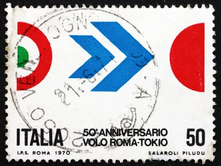 arturo: ITALY - CIRCA 1970: a stamp printed in the Italy shows Symbol of Flight, Colors of Italy and Japan, 50th Anniversary of Arturo Ferrarins Flight from Rome to Tokyo, circa 1970 Editorial