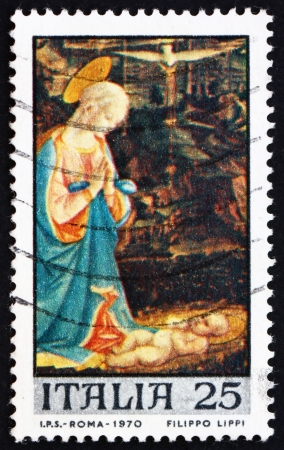 ITALY - CIRCA 1970: a stamp printed in the Italy shows Virgin and Child, Painting by Fra Filippo Lippi, Christmas, circa 1970 Stock Photo - 14720457