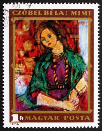 HUNGARY - CIRCA 1974: a stamp printed in the Hungary shows Mimi, Painting by Bela Czobel, 91st Birthday of Bela Czobel, Hungarian Painter, circa 1974 Stock Photo - 14720446