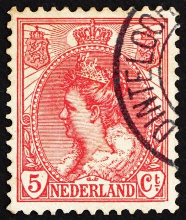 wilhelmina: NETHERLANDS - CIRCA 1898: a stamp printed in the Netherlands shows Queen Wilhelmina, circa 1898