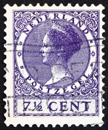 wilhelmina: NETHERLANDS - CIRCA 1927: a stamp printed in the Netherlands shows Queen Wilhelmina, circa 1927