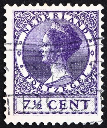 wilhelmina: NETHERLANDS - CIRCA 1927: a stamp printed in the Netherlands shows Queen Wilhelmina, circa 1927