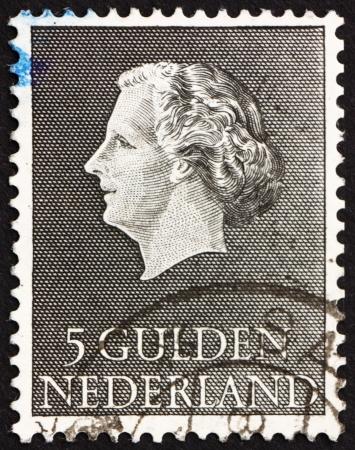 juliana: NETHERLANDS - CIRCA 1955: a stamp printed in the Netherlands shows Queen Juliana, circa 1955