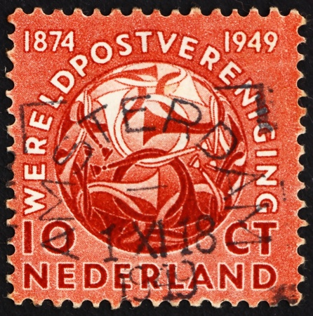 upu: NETHERLANDS - CIRCA 1949: a stamp printed in the Netherlands shows Post Horns Entwined, 75th Anniversary of the UPU, circa 1949 Editorial