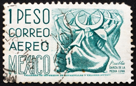 MEXICO - CIRCA 1950: a stamp printed in the Mexico shows Puebla, Dance of the Half Moon, circa 1950