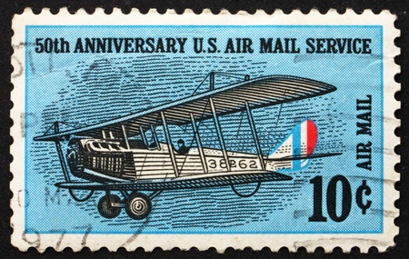jenny: UNITED STATES OF AMERICA - CIRCA 1968: a stamp printed in the USA shows Curtiss Jenny, Biplane, circa 1968 Editorial