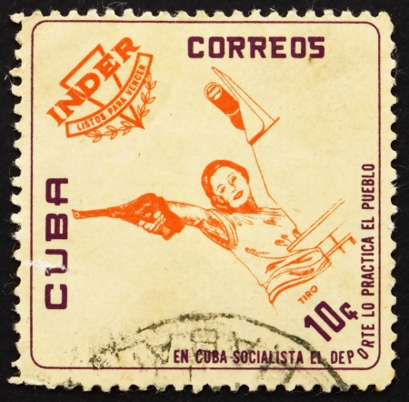 CUBA - CIRCA 1962: a stamp printed in the Cuba shows Pistol Shooting, National Sports Institute Emblem and Athletes, circa 1962