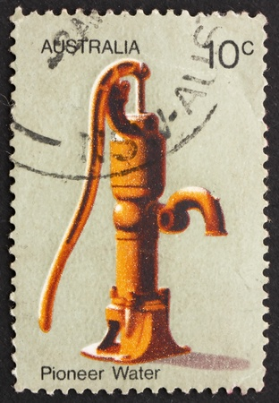 AUSTRALIA - CIRCA 1972: a stamp printed in the Australia shows Water Pump, Australian Pioneer Life, circa 1972