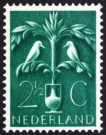 germanic: NETHERLANDS - CIRCA 1943: a stamp printed in the Netherlands shows Tree of Life, Old Germanic Symbol, circa 1943