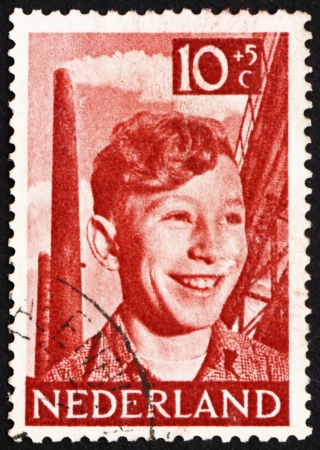 steelwork: NETHERLANDS - CIRCA 1951: a stamp printed in the Netherlands shows Boy, Chimneys and Steelwork, circa 1951 Editorial