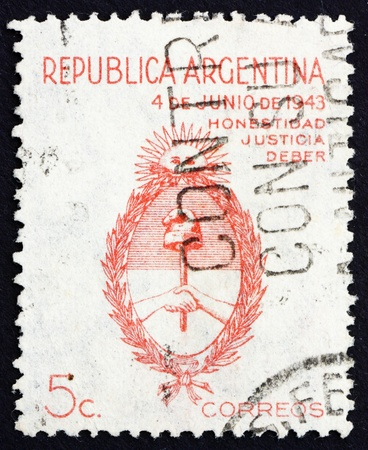 inscribed: ARGENTINA - CIRCA 1943: a stamp printed in the Argentina shows Coat of Arms of Argentina Inscribed, Honesty, Justice, Duty, circa 1943