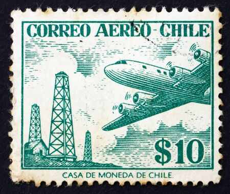 CHILE - CIRCA 1967: a stamp printed in the Chile shows Oil Derricks and Douglas DC-6, circa 1967