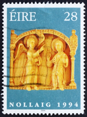 11th century: IRELAND - CIRCA 1994: a stamp printed in the Ireland shows Annunciation, Detail, 11th Century Ivory Plaque, Christmas, circa 1994