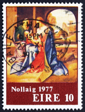 irish christmas: IRELAND - CIRCA 1977: a stamp printed in the Ireland shows Holy Family, Painting by Giorgione, Christmas, circa 1977