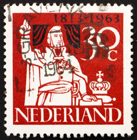 allegiance: NETHERLANDS - CIRCA 1963: a stamp printed in the Netherlands shows Prince William Taking Oath of Allegiance, 150th Anniversary of the Kingdom of the Netherlands, circa 1963