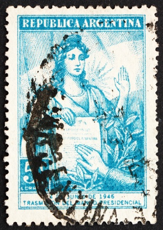 peron: ARGENTINA - CIRCA 1946: a stamp printed in the Argentina shows Liberty Administering Presidential Oath, Inauguration of President Juan D. Peron, circa 1946