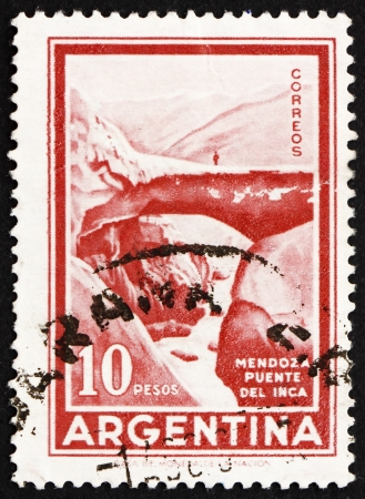 ARGENTINA - CIRCA 1960: a stamp printed in the Argentina shows Inca Bridge, natural arch over the Vacas River, Mendoza, Argentina, circa 1960