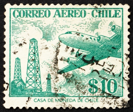 CHILE - CIRCA 1956: a stamp printed in the Chile shows Oil Derricks and Douglas DC-6, circa 1956