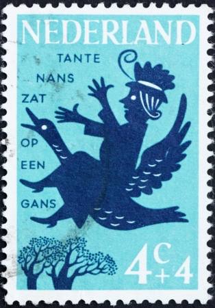 NETHERLANDS - CIRCA 1963: a stamp printed in the Netherlands shows Aunt Lucy Sat on a Goosey, Nursery Rhymes, circa 1963 Stock Photo - 14904799