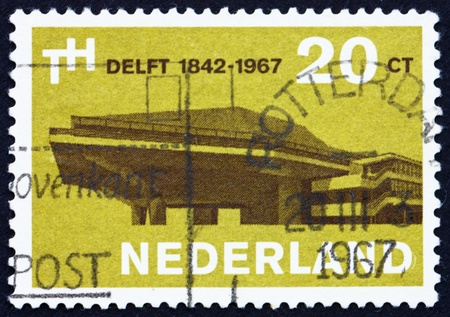 founding: NETHERLANDS - CIRCA 1967: a stamp printed in the Netherlands shows Assembly Hall, Delft University, 125th Anniversary of the Founding, circa 1967