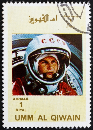 yuri: UMM AL-QUWAIN - CIRCA 1972: a stamp printed in the Umm al-Quwain shows Yuri A. Gagarin, Astronaut, the First Human into Outer Space, circa 1972 Editorial