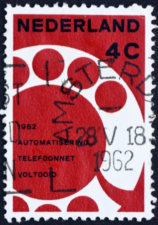 NETHERLANDS - CIRCA 1962: a stamp printed in the Netherlands shows Telephone Dial, Completion of the Automation of the Netherlands Telephone Network, circa 1962
