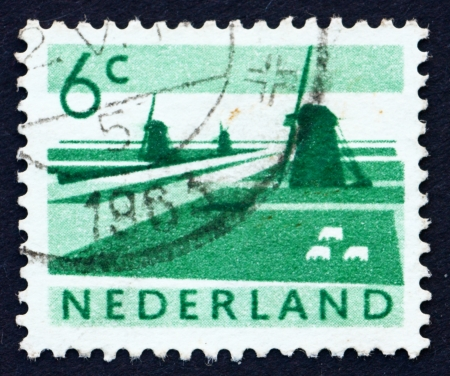 NETHERLANDS - CIRCA 1962: a stamp printed in the Netherlands shows Polder with Canals and Windmills, circa 1962
