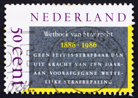 NETHERLANDS - CIRCA 1986: a stamp printed in the Netherlands shows Dutch Penal Code, Centenary, circa 1986 Stock Photo - 14914627