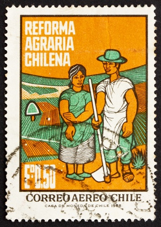 agrarian: CHILE - CIRCA 1968: a stamp printed in the Chile shows Farm Couple, Agrarian Reforms, circa 1968 Editorial