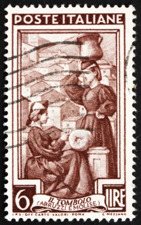 molise: ITALY - CIRCA 1950: a stamp printed in the Italy shows Lace-making, Abruzzi e Molise, circa 1950