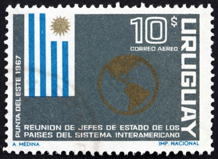 URUGUAY - CIRCA 1967: a stamp printed in the Uruguay shows Flag of Uruguay and Map of the Americas, Meeting of American Presidents, Punta del Este, circa 1967