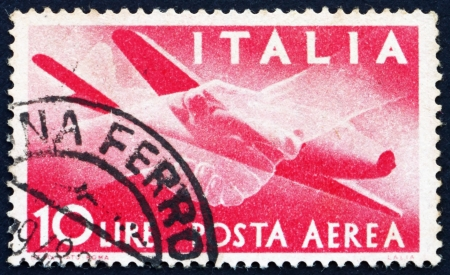 ITALY - CIRCA 1945: a stamp printed in the Italy shows Plane and Clasped Hands, circa 1945