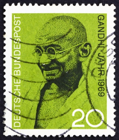 nonviolent: GERMANY - CIRCA 1969: a stamp printed in the Germany shows Mahatma Gandhi, portrait, circa 1969