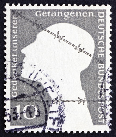 prisoner of war: GERMANY - CIRCA 1953: a stamp printed in the Germany shows War Prisoner and Barbed Wire, circa 1965