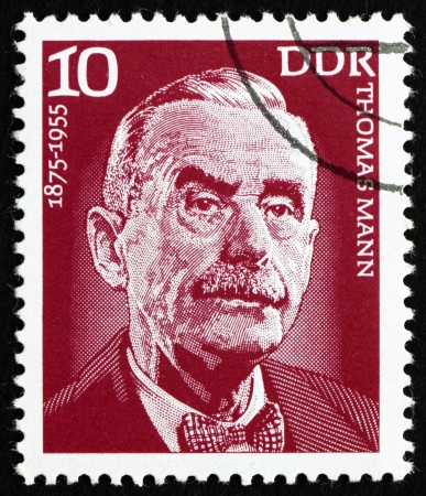 GDR - CIRCA 1975: a stamp printed in GDR shows Thomas Mann, Writer, Novelist, Essayist, circa 1975 Stock Photo - 15318436