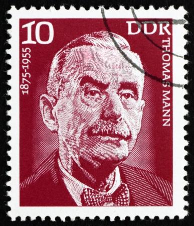 GDR - CIRCA 1975: a stamp printed in GDR shows Thomas Mann, Writer, Novelist, Essayist, circa 1975 Stock Photo - 15318436