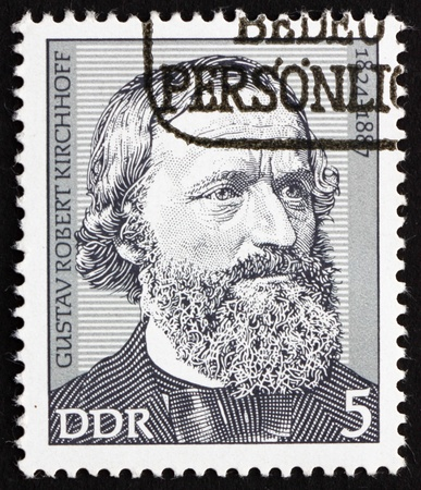 physicist: GDR - CIRCA 1974: a stamp printed in GDR shows Gustav Robert Kirchhoff, Physicist, circa 1974
