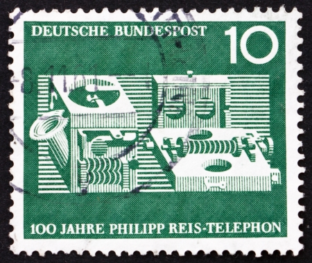centenary: GERMANY - CIRCA 1961: a stamp printed in the Germany shows Reis Telephone, Centenary of the Demonstration of the 1st Telephone by Philipp Reis, circa 1961 Editorial