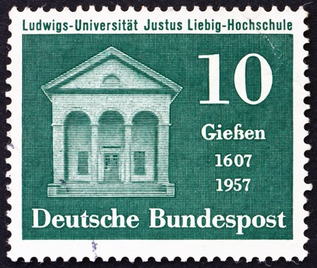 GERMANY - CIRCA 1957: a stamp printed in the Germany shows Liebig Laboratory, 350th Anniversary of the Justus Liebig School at Ludwig University, Giessen, circa 1957 Stock Photo - 15336887