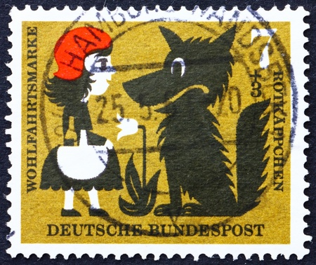 GERMANY - CIRCA 1960: a stamp printed in the Germany shows Little Red Riding Hood and the Wolf, Scene from Little Red Riding Hood, circa 1960