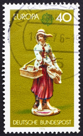 GERMANY - CIRCA 1976: a stamp printed in the Germany shows Girl Selling Trinkets and Prints, Porcelain, circa 1976