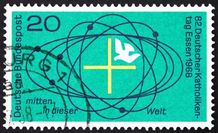 GERMANY - CIRCA 1968: a stamp printed in the Germany shows Cross and Dove in Center of Universe, 82nd Meeting of German Catholics, Essen, circa 1968