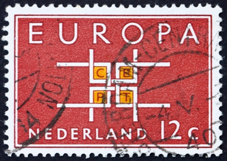 NETHERLANDS - CIRCA 1963: a stamp printed in the Netherlands shows Stylized Links, Symbolizing Unity, European Community, circa 1963