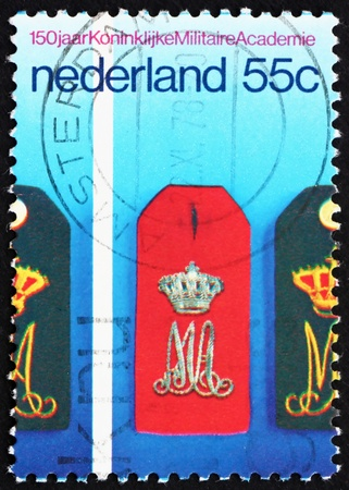 epaulettes: NETHERLANDS - CIRCA 1978: a stamp printed in the Netherlands shows Epaulettes, Military Academy, Sesquicentennial of Royal Military Academy, circa 1978