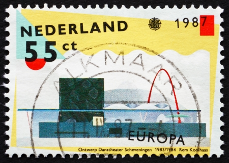NETHERLANDS - CIRCA 1987: a stamp printed in the Netherlands shows Scheveningen Dance Theater, designed by Rem Koolhaas, Modern Architecture, circa 1987 Stock Photo - 15486374