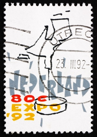 NETHERLANDS - CIRCA 1992: a stamp printed in the Netherlands shows Dutch Map, EXPO 92, Seville, Spain, circa 1992 Stock Photo - 15486358