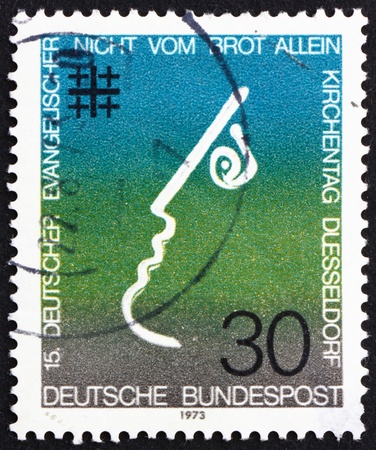 synod: GERMANY - CIRCA 1973: a stamp printed in the Germany shows Not by Bread Alone, 15th Meeting of German Protestants, Evangelical Synod, Dusseldorf, circa 1973 Editorial
